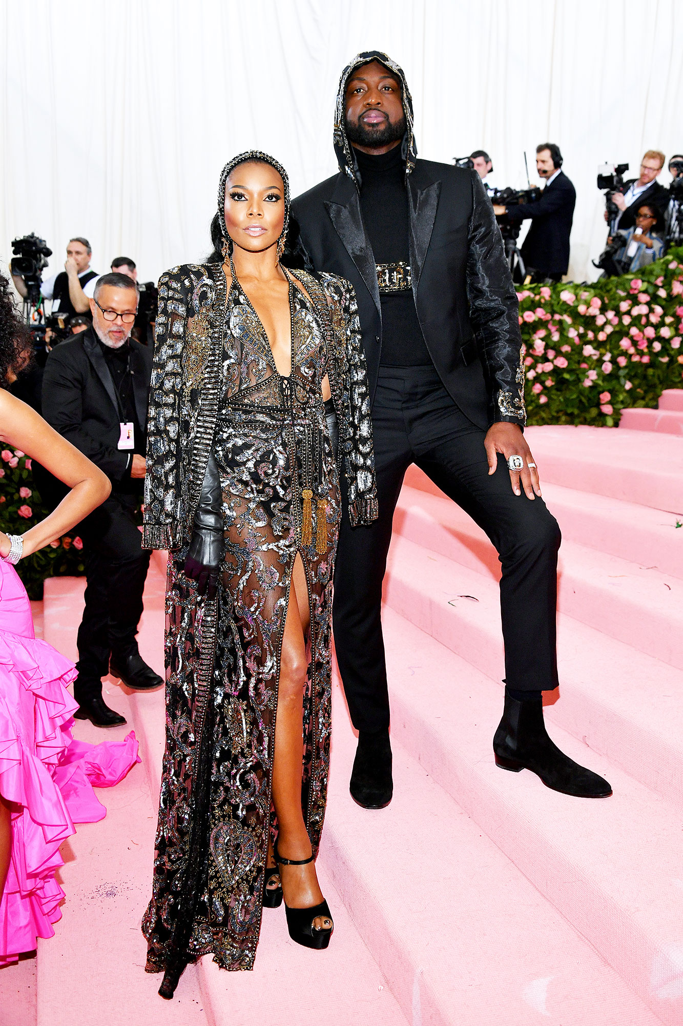 Gabrielle Union and Dwyane Wade met gala 2019 couples - The super stylish couple sported matching headpieces that paired perfectly with Union's nearly naked Dundas design.