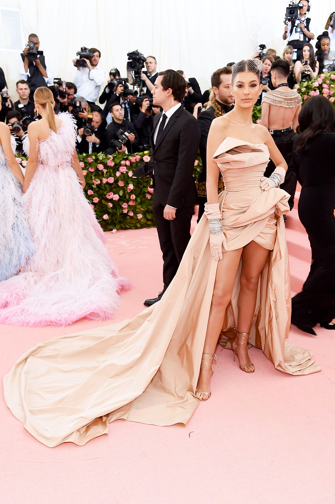 Camila Morrone met gala 2019 - Wearing a champagne-colored Elie Saab mini with a dramatic train.