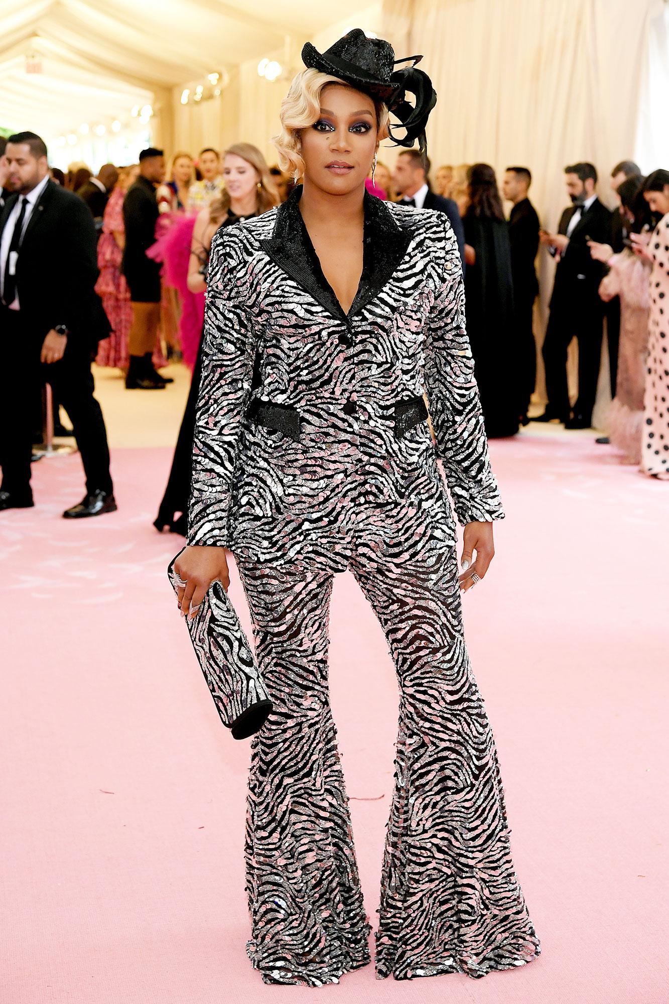 Tiffany Haddish met gala 2019 - Wearing a sequined animal-print Michael Kors suit with Butani, Djula and Hueb jewels.