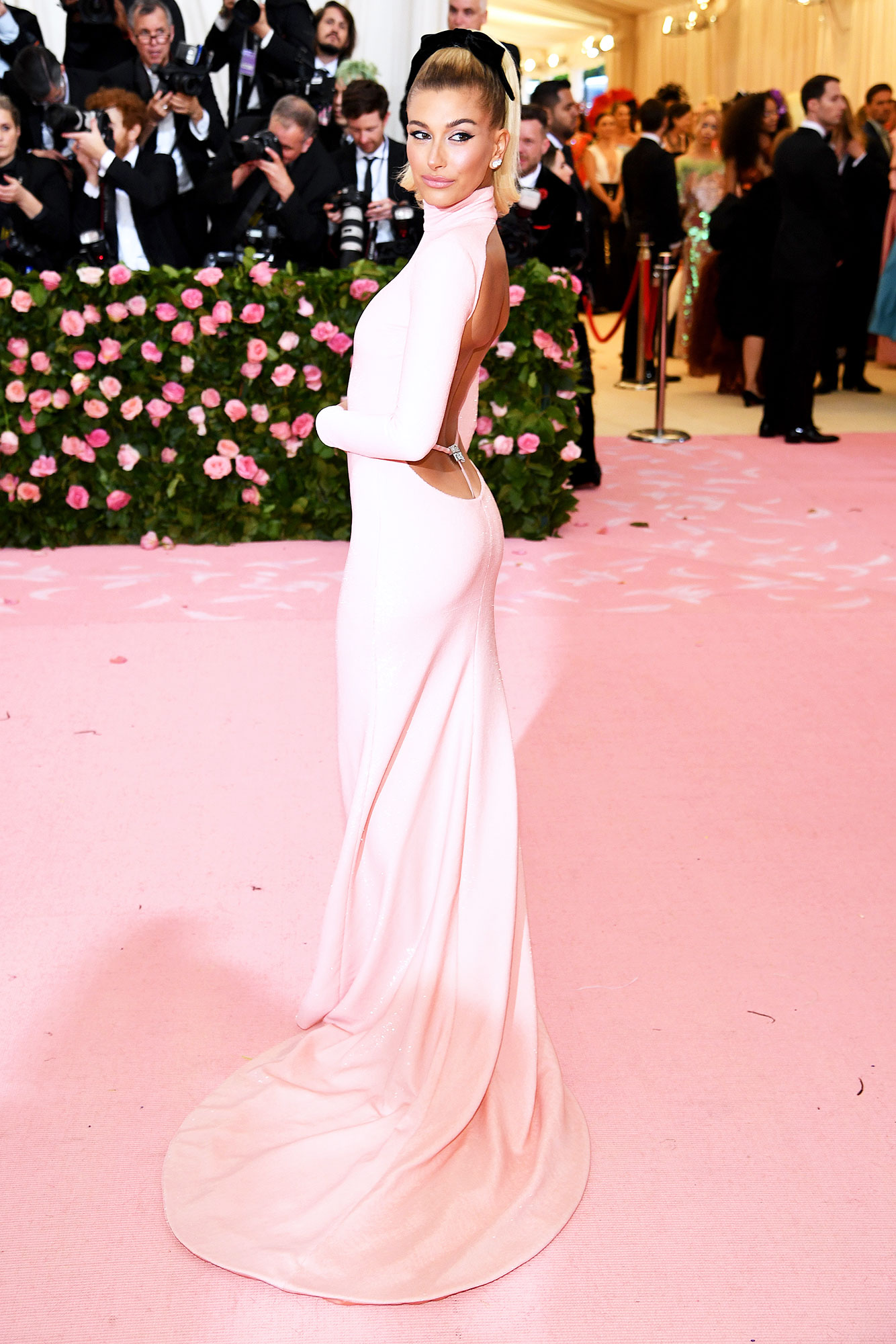 Hailey Bieber met gala 2019 - Wearing a pink Alexander Wang gown with Stuart Weitzman heels and Bulgari jewels.