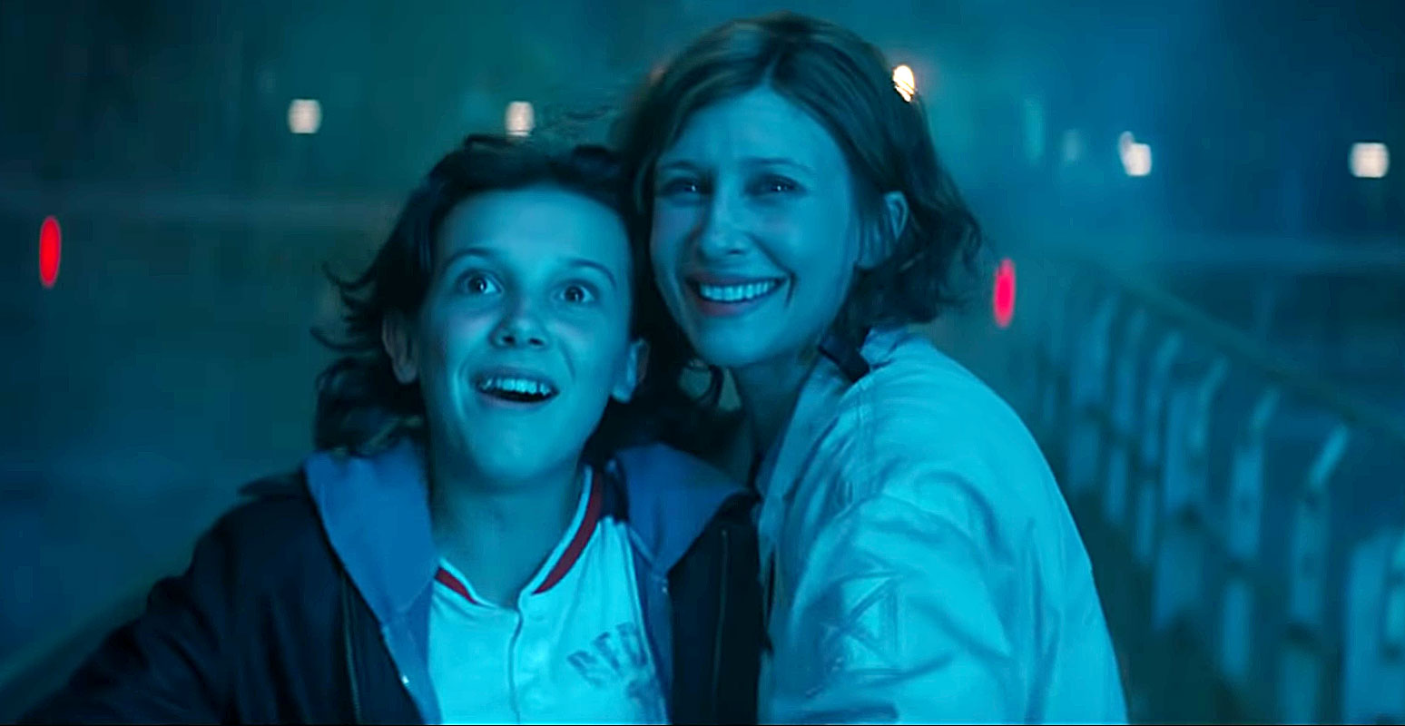 """Can't Miss Summer Movie Preview - Sure, it's cool starring in a blockbuster summer movie, but Vera Farmiga , who plays Dr. Emma Russell in the franchise sequel (alongside costar Millie Bobby Brown ) really just wanted to wow her children, Gytta, 8, and Fynn, 10. """"I thought my kids would be impressed watching their mama handle God-size lizards with brawn and finesse, trying to save the world, she says, noting that it was refreshing to play a fierce mama bear."""