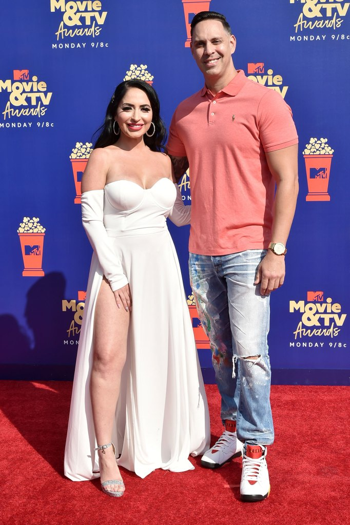 Angelina Pivarnick Wears A White Dress with Open Leg At MTV Video and TV Awards and Chris Larangeira Wears Sneakers, Ripped Jeans and a Polo Shirt