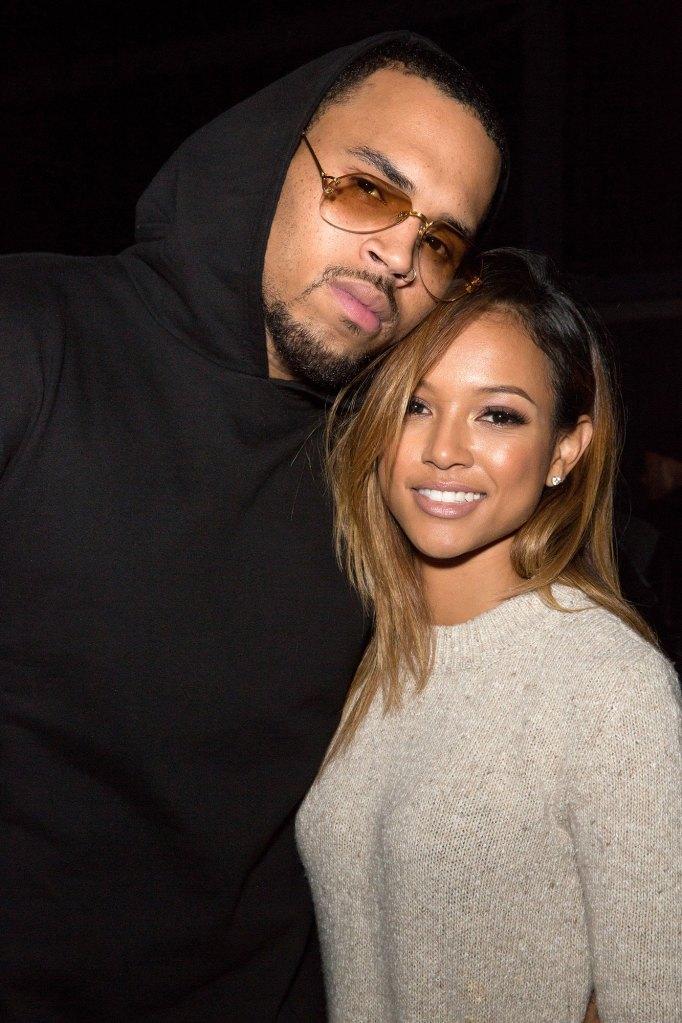 Chris Brown Wearing Glasses Goate Black Hoodie And Karrueche Tran
