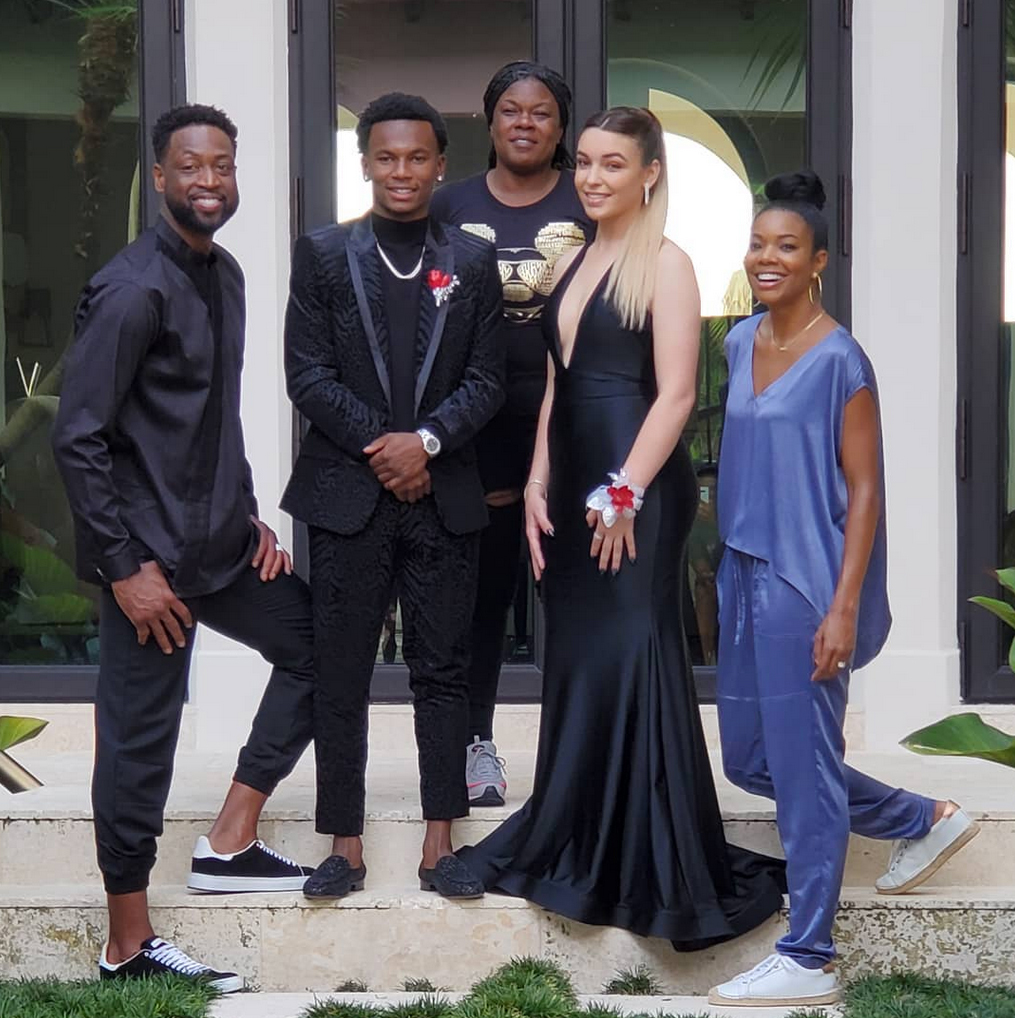Dwyane-Wade-prom - The athlete and his wife looked so happy with 17-year-old Zaire on his prom night.