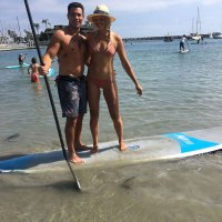 Gina Kirschenheiter and Matthew Kirschenheiter On A Water Board In Bathing Suit and Bikini