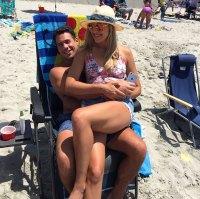 Gina Kirschenheiter and Matthew Kirschenheiter Sitting On The Beach