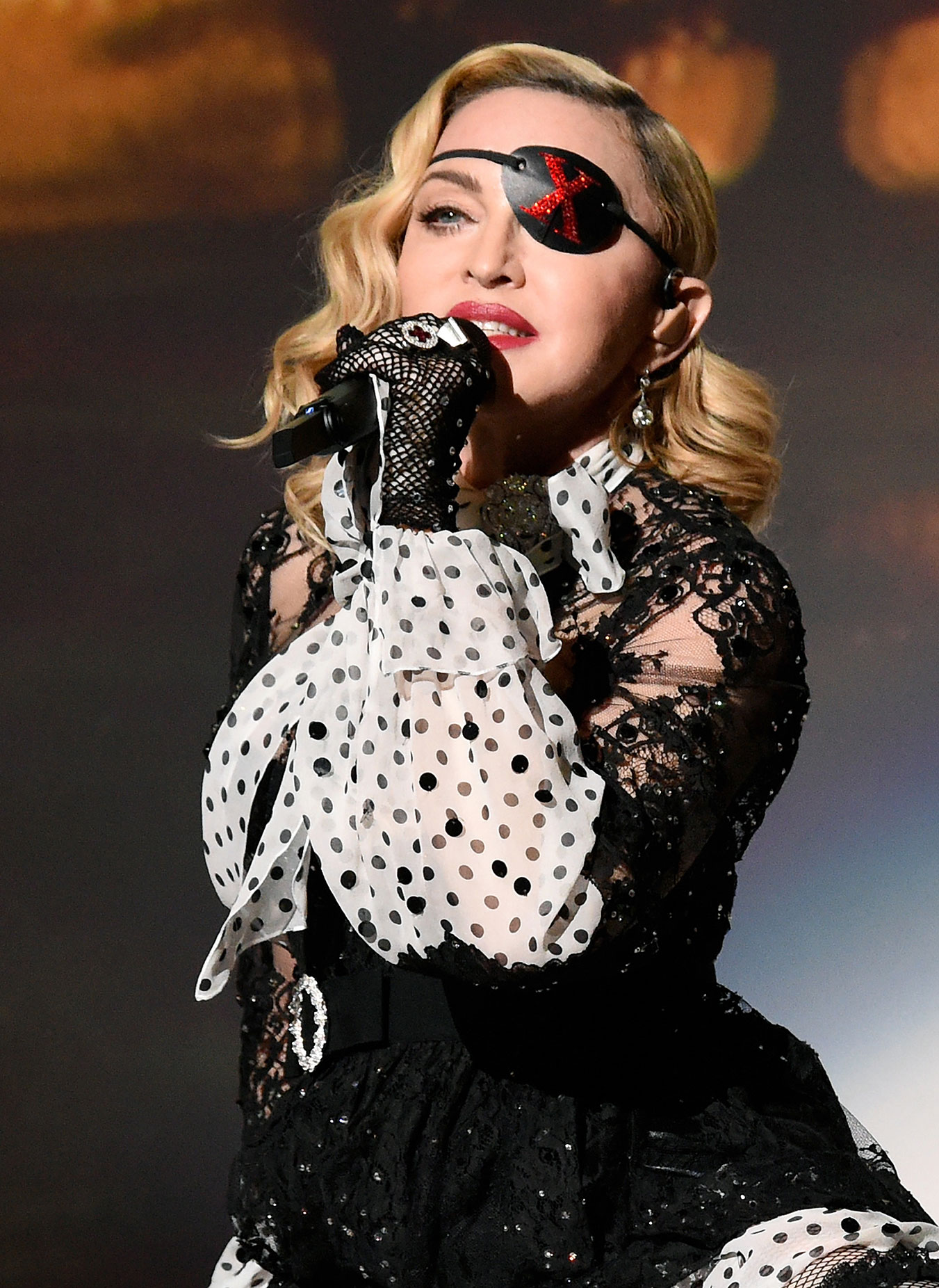 Madonna Sings At The 2019 Billboard Music Awards Eye Patch Madame X - Madonna performs at the Billboard Music Awards at MGM Grand Garden Arena in Las Vegas on May 1, 2019.