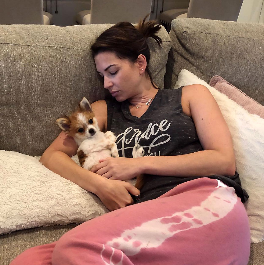 Melissa Rycroft Feeling Sick Wearing Sweat Pants Sitting On Couch Holding Little Dog