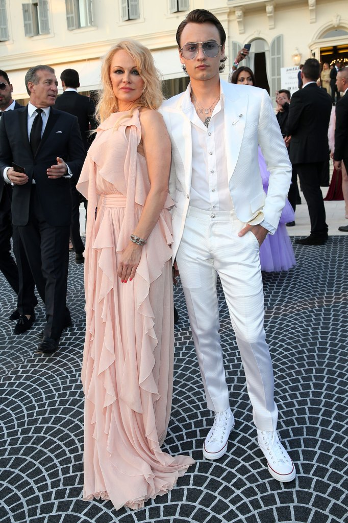 Pamela Anderson and Brandon Lee Dressed in All White Suit
