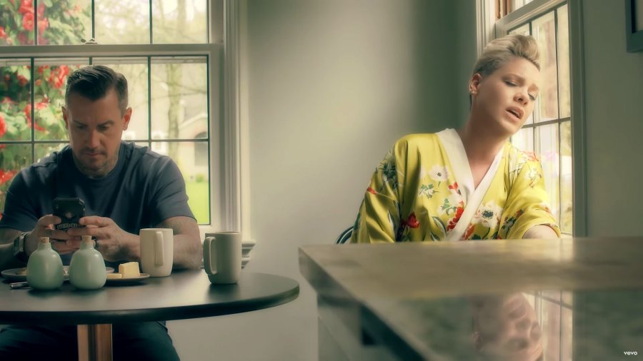 Pink and Carey Hart New Music Video Yellow Bath Robe With Flowers On Phone Drinking Coffee