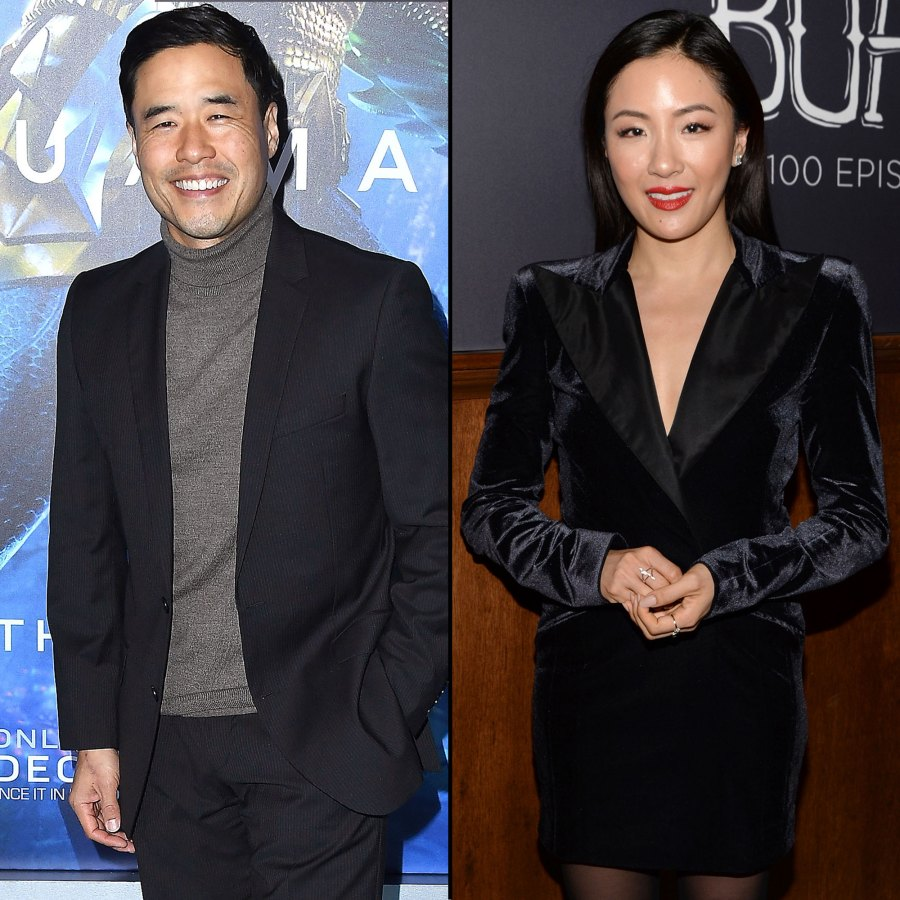 Randall Park and Constance Wu Smile Wearing Black Sports Jacket and Black Dress