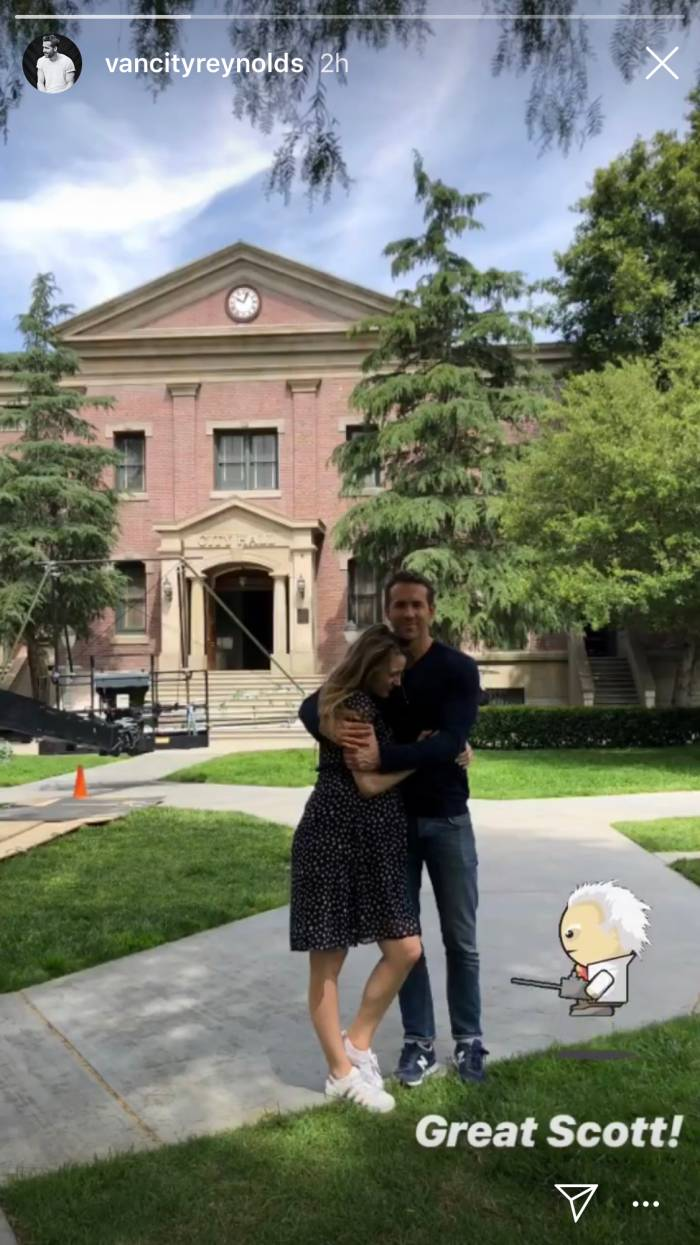 Ryan Reynolds and Blake Lively stand in front of the clock tower from Back To The Future