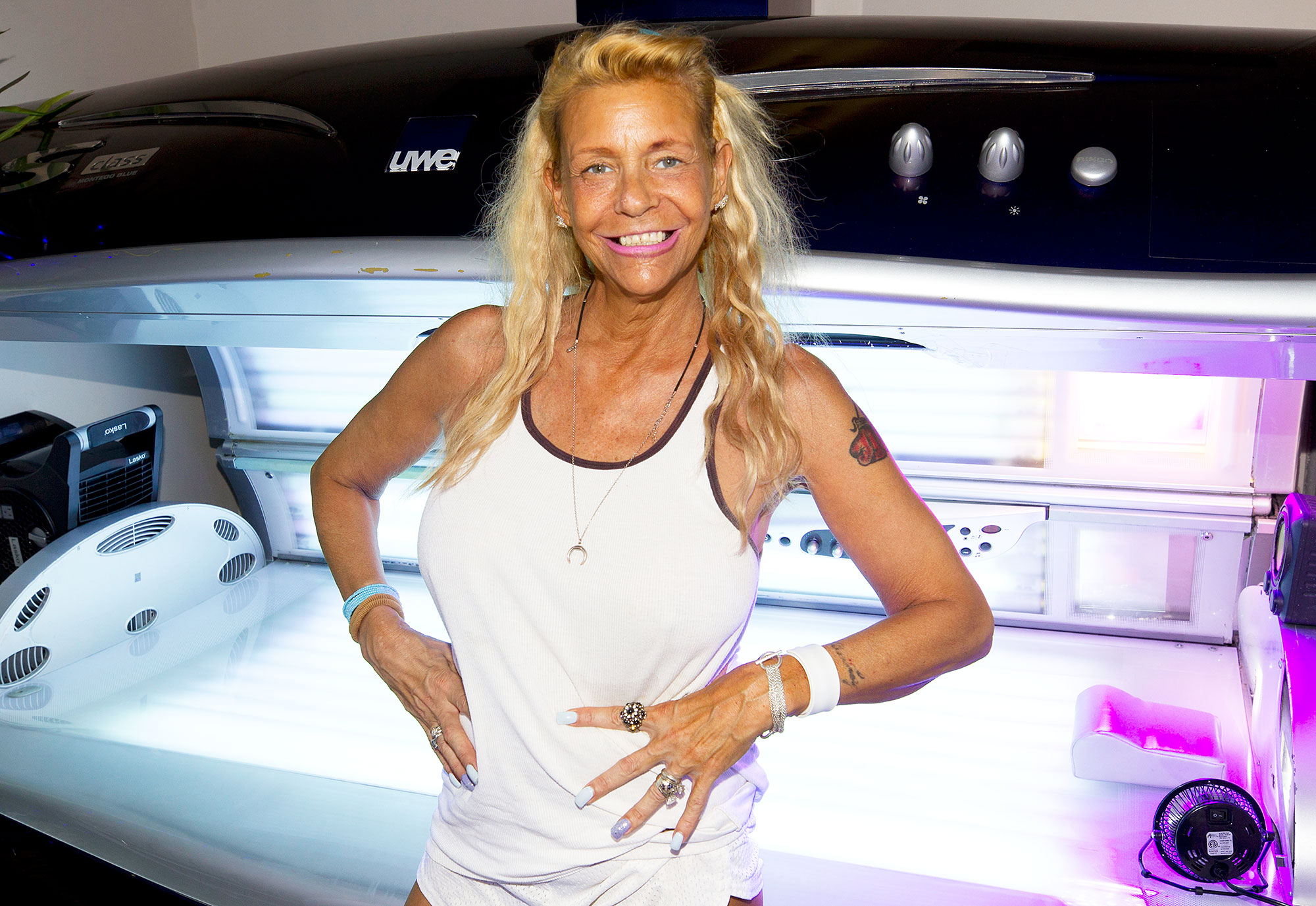 Tan Mom Patricia Krentcil Poses In Front of a Tanning Bed Ready to Take the Music Business By Storm