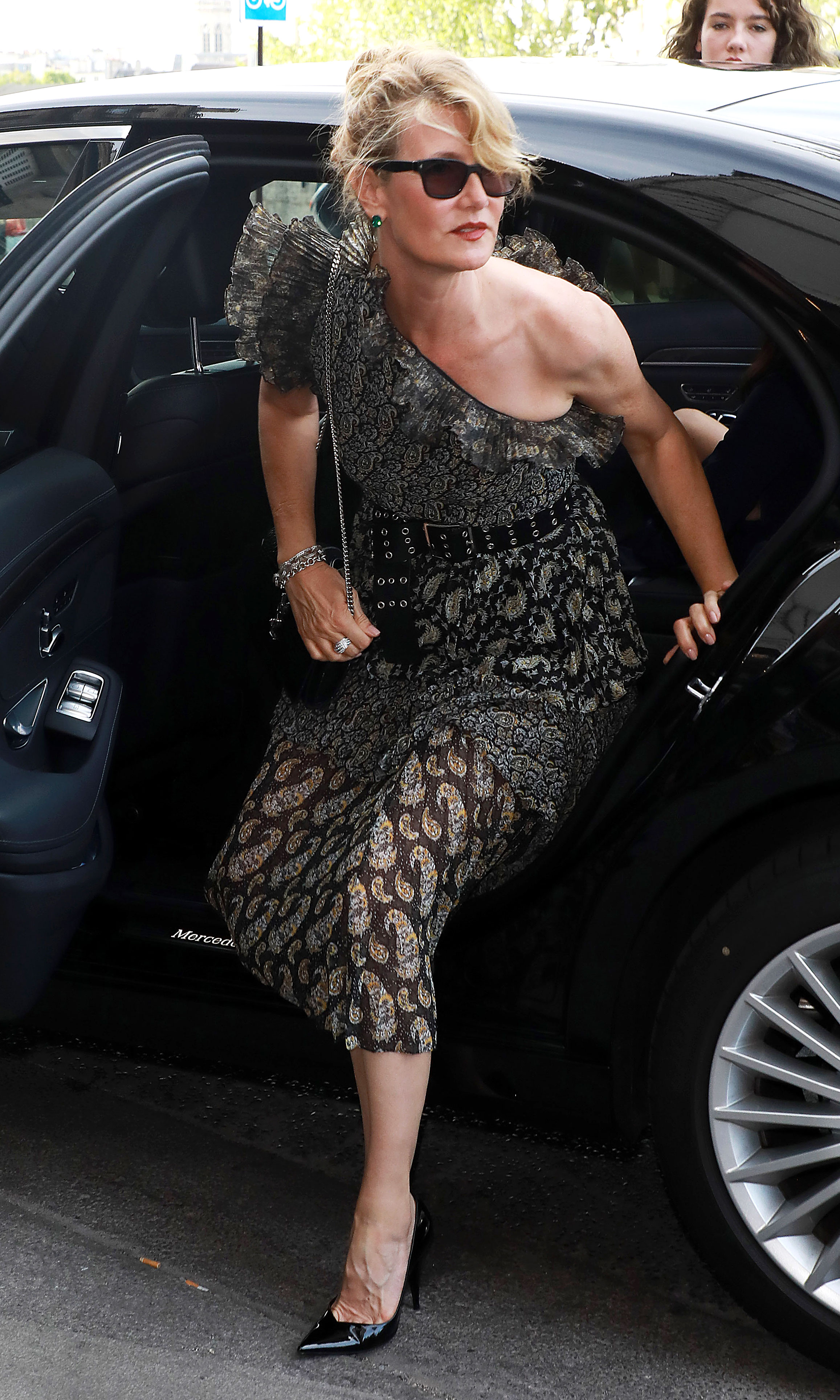 Zoe Kravitz Karl Glusman attend pre-wedding party French restaurant Lapérous Paris - Dern was glamorous as could be while exiting her car in an asymmetrical, single-sleeve cocktail dress to join in on the festivities.
