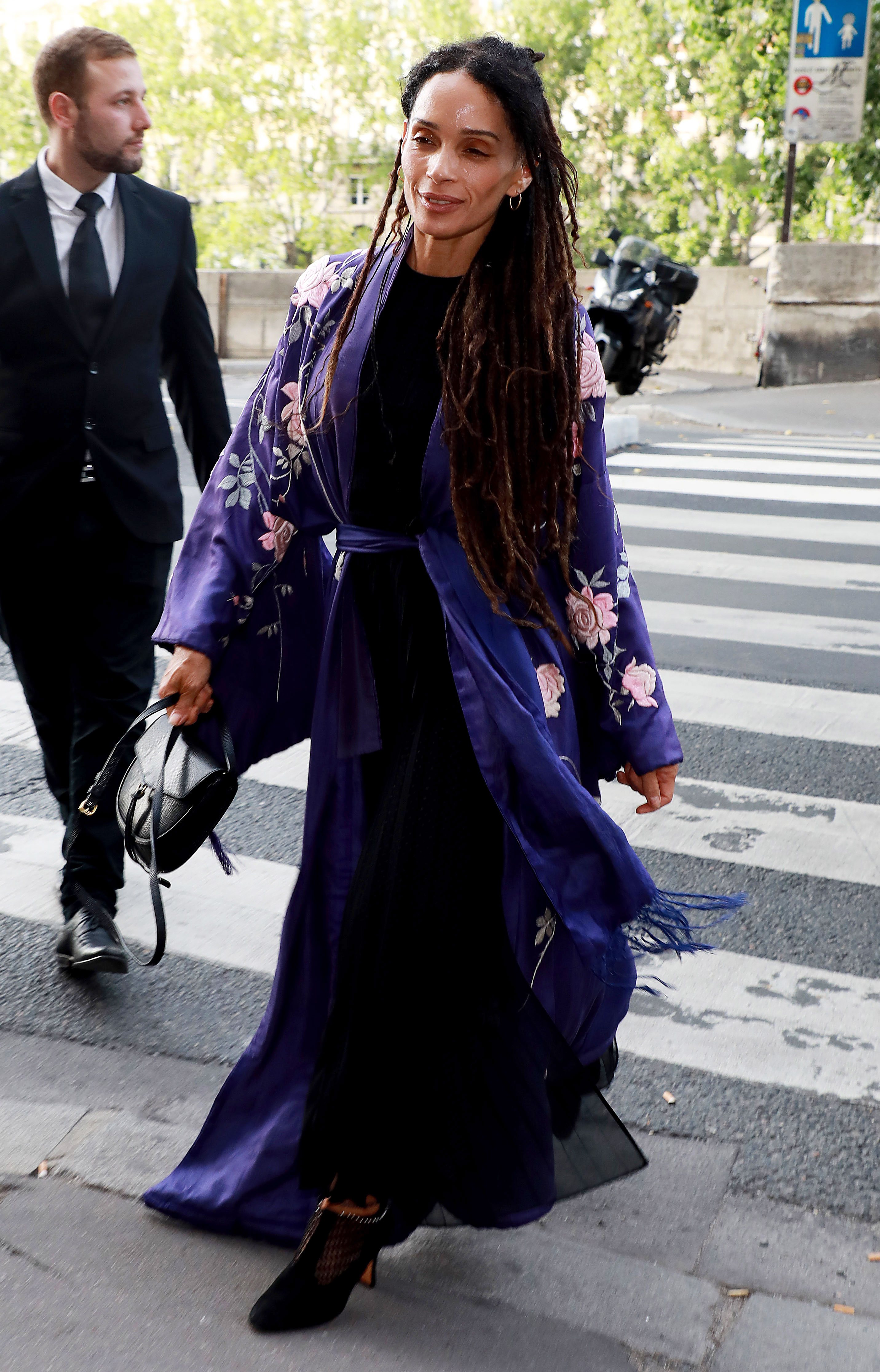 Zoe Kravitz Karl Glusman attend pre-wedding party French restaurant Lapérous Paris - Zoë's look-alike mother appeared perfectly at ease in a flowing violet kimono coat.