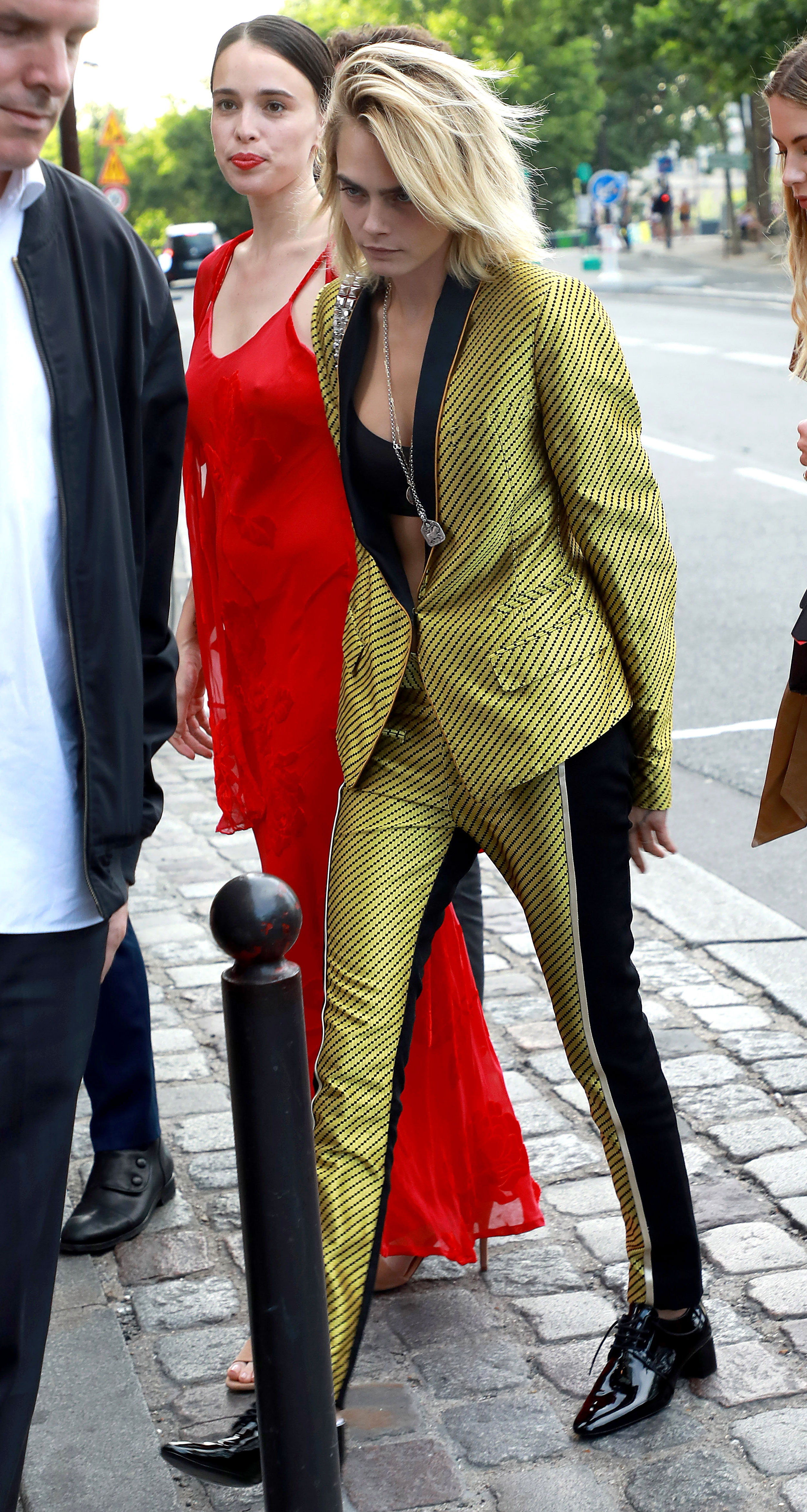 Zoe Kravitz Karl Glusman attend pre-wedding party French restaurant Lapérous Paris - Delevingne was ready to stop traffic in a bold yellow and black diagonal print suit with black stripes.