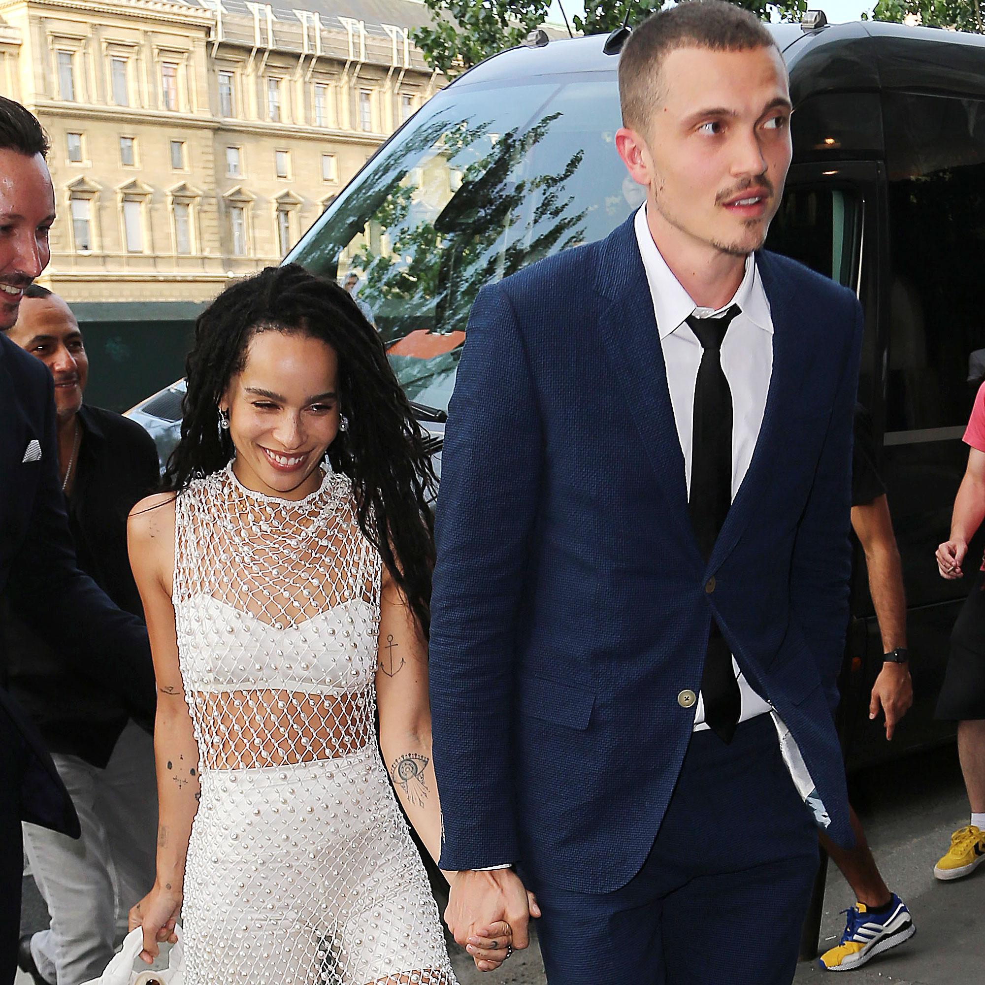 Zoe Kravitz Karl Glusman attend pre-wedding party French restaurant Lapérous Paris - Zoë beamed as she held her spouse's hand outside the Parisian venue.