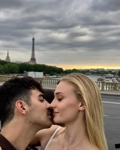 Joe Jonas and Sophie Turner in Paris about to kiss.