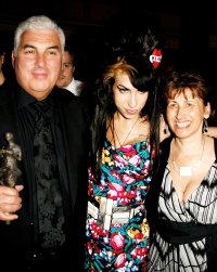 Amy Winehouse, her father Mitch and mother Janis