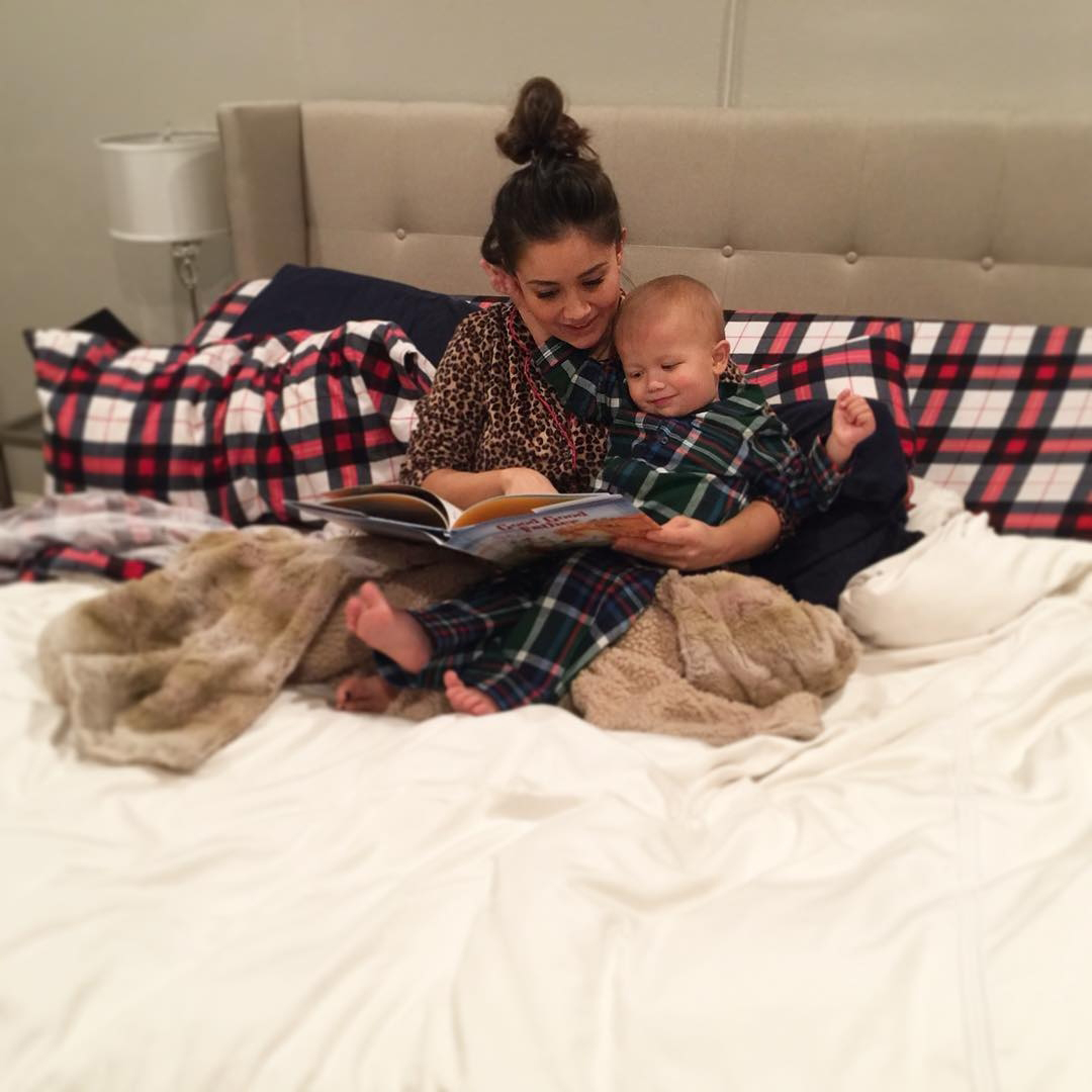"""Catherine Giudici and Sean Lowe Family Album - """"Two things Samuel loves: reading in bed with his Mama... and my hair,"""" she wrote in December 2017. """"My favorite place is to be near him. Don't tell Sean that Samuel is my top choice for cuddle buddy."""""""