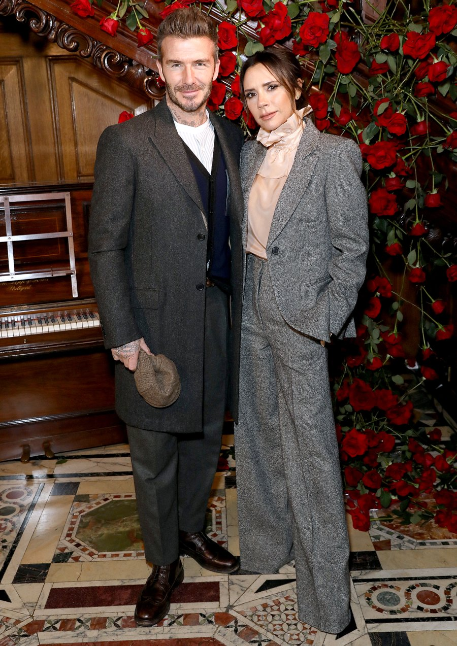David-and-Victoria-Beckham-suits-rose-wall