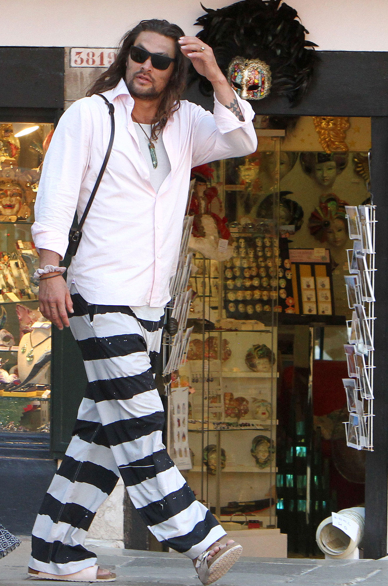 Jason Momoa Explore Italy Black and White Striped Pants and Sandals Sunglasses - Momoa showed off his eclectic style while walking in the Italian city.