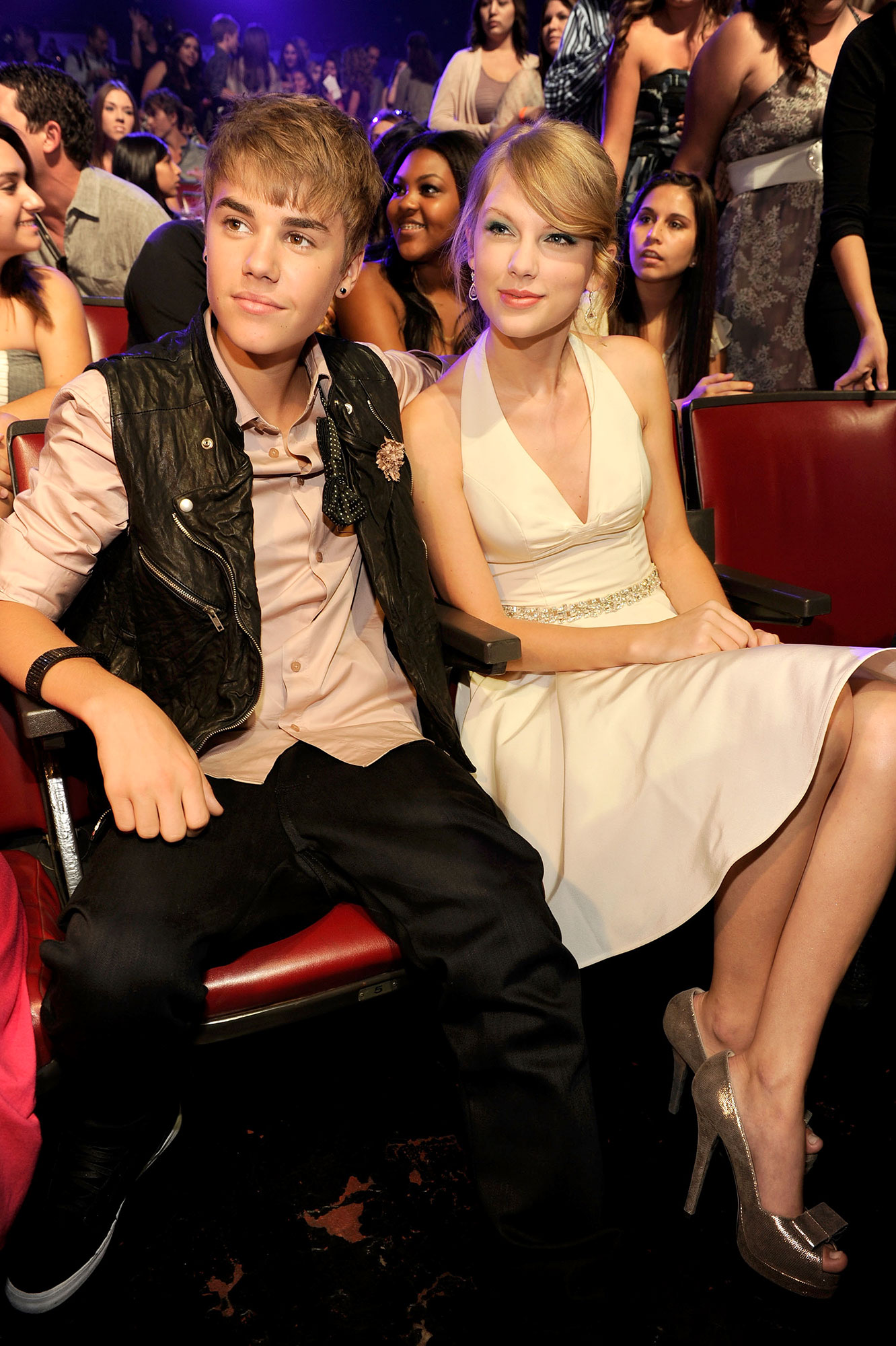 Justin Bieber and Taylor Swift 2011 Teen Choice Awards - Rumors surfaced in 2013 that Swift didn't like Bieber after she stuck her tongue out when the singer kissed then-girlfriend Selena Gomez, Swift's close friend, backstage at the Billboard Music Awards. It wasn't until Bieber was mentioned in Swift's aforementioned post about Braun, however, that she addressed any issues between them.