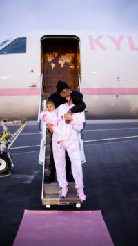 1f8fb9489b46 Kylie Jenner Kisses Boyfriend Travis Scott on Steps of Custom Private Plane  Ahead of Girls' Trip With Stormi