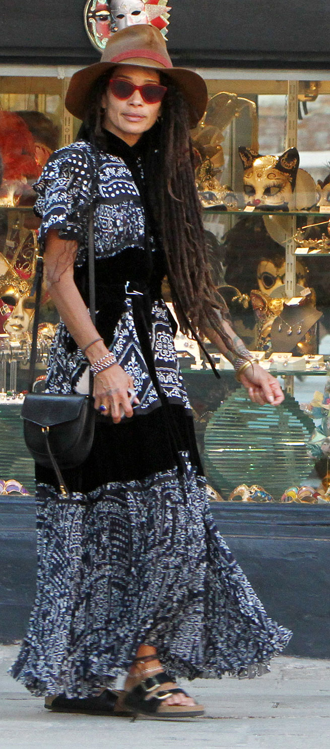 Lisa Bonet Explore Italy Brown Rim Hat Walking - Bonet stopped to pose for several snaps for Momoa along the way.
