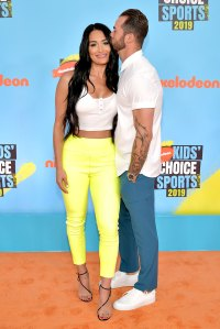 Nikki Bella and Artem Chigvintsev Red Orange Carpet Nickelodeon Kids' Choice Sports 2019