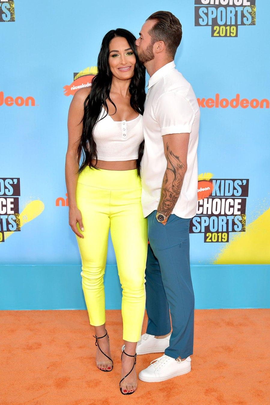 Nikki Bella and Artem Chigvintsev Red Orange Carpet Nickelodeon Kids' Choice Sports 2019