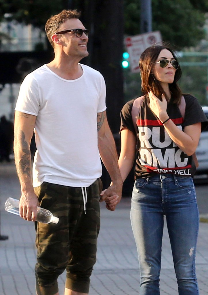 Brian Austin Green Initially Turned Down Wife Megan Fox Wearing a 'Run DMC - Raising Hell' T-shirt, With Blue Jeans, while Brian Wearing a White T-Shirt, Camouflage Jogging Short Pants