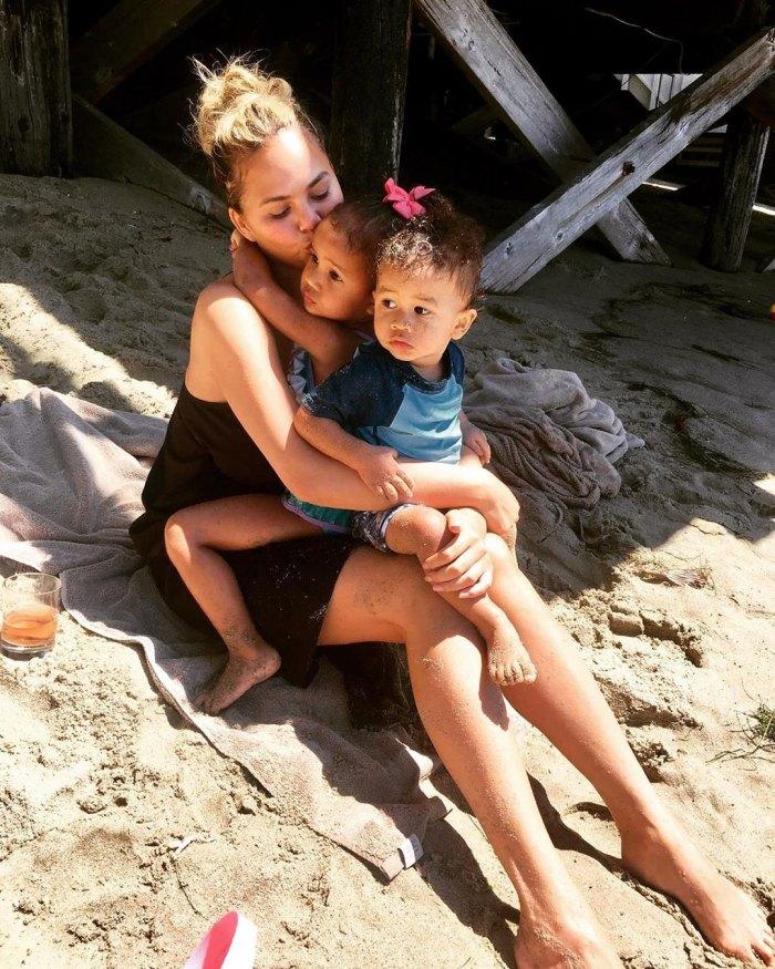 Chrissy Teigen Beach With Luna Miles