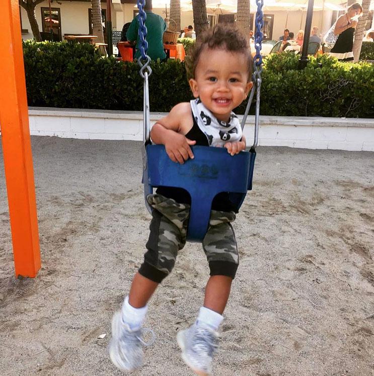 Chrissy Teigen Miles On Baby Swing