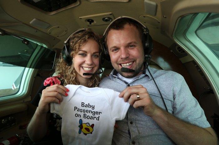 John David Duggar Wife Abbie Burnett Pregnant Baby Announcement Plane Onesie