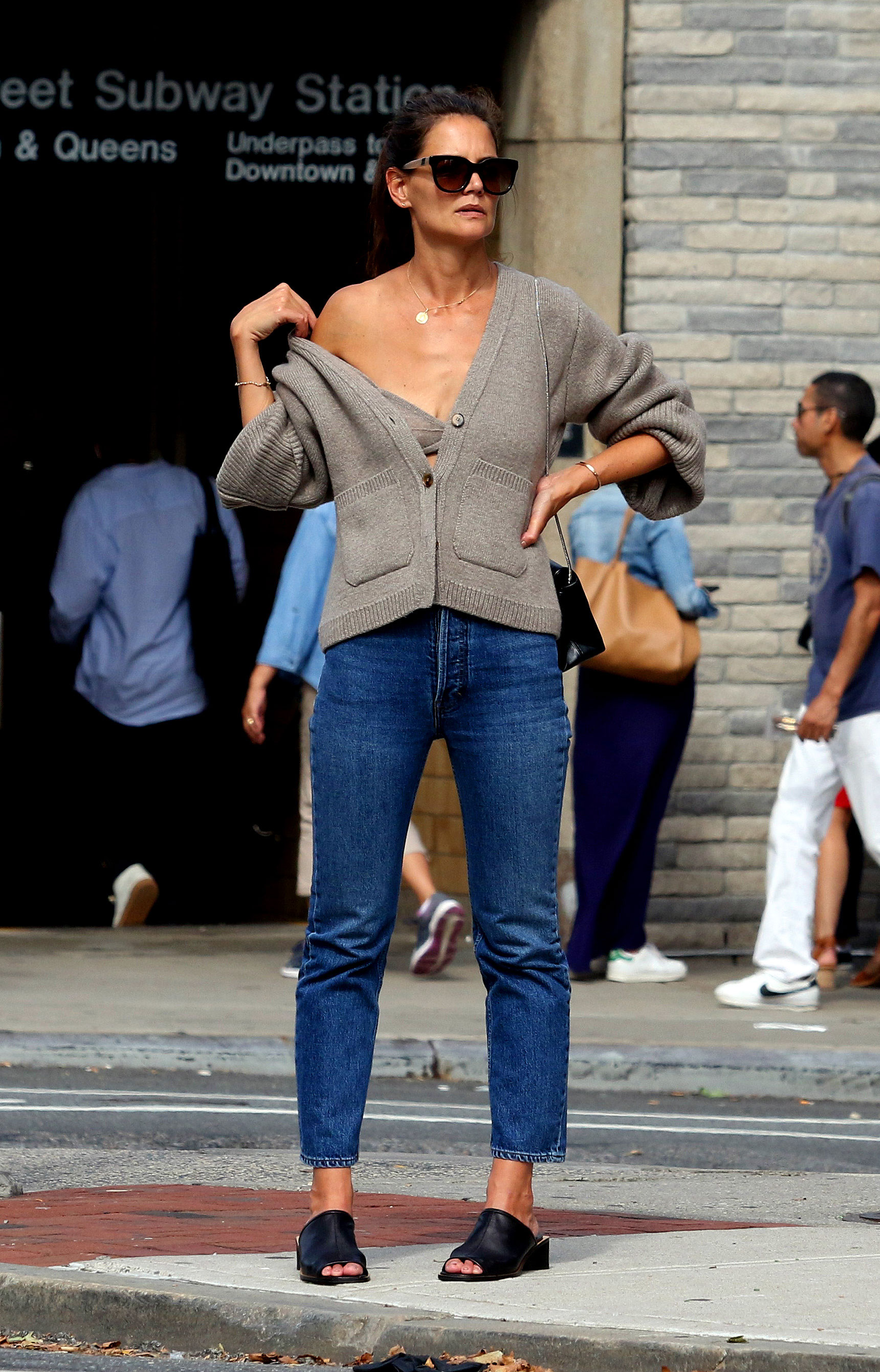 Katie Holmes Wears Revealing Outfit in New York City After Jamie Foxx Split - The actress paired the cardigan with blue jeans, black sandals and dark shades.