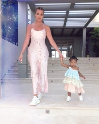 Khloe Kardashian and Daughter True Hold Hands