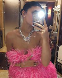 Diamonds and Pink feather dress Kylie Jenner Rings in Her 22nd Birthday With Shots, Exquisite Flowers and a Lavish Diamond Necklace From Travis Scott