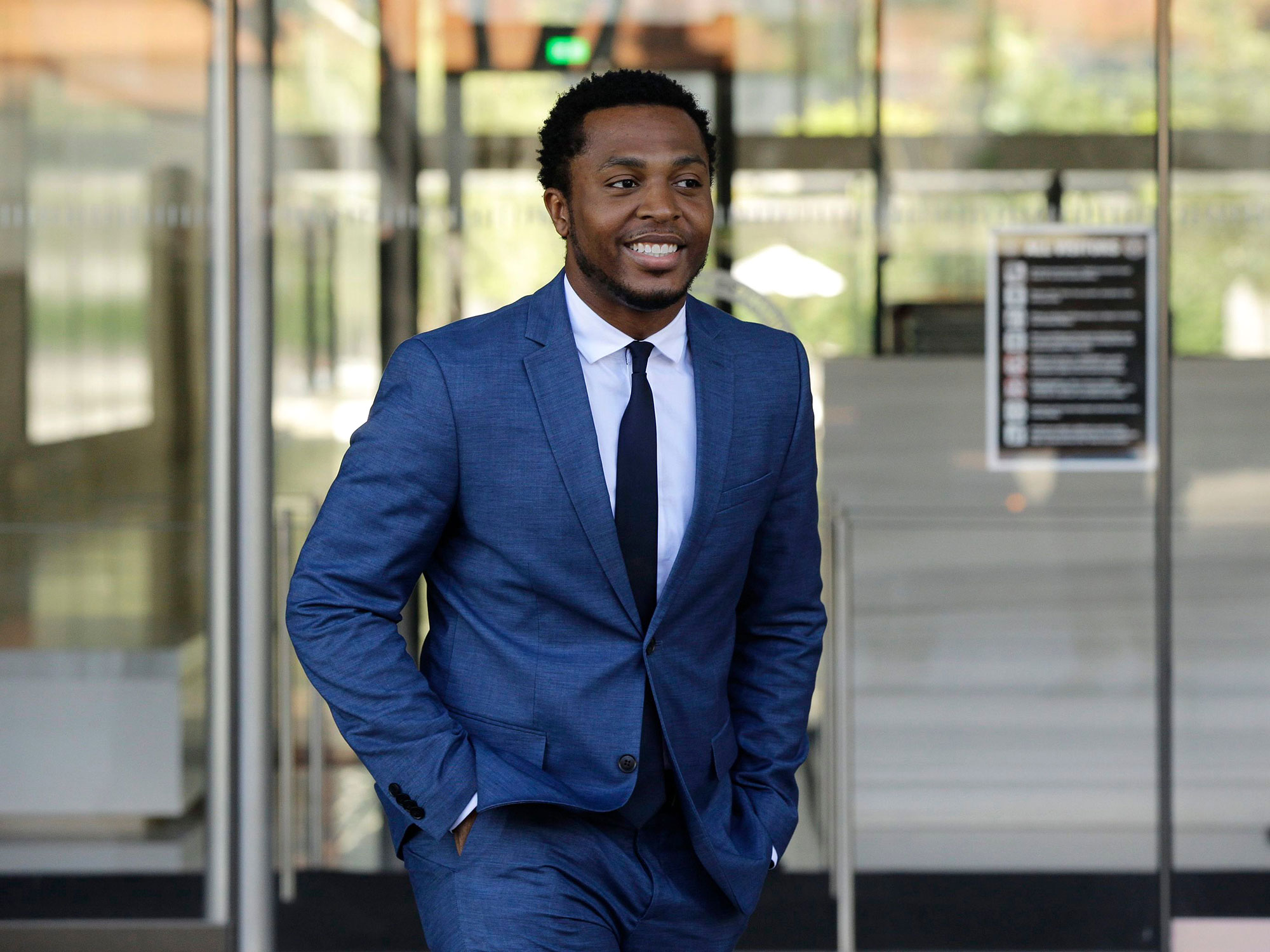 Marcus Gray Defeats Katy Perry In Court - Marcus Gray smiles as he leaves the federal courthouse August 1, 2019 in Los Angeles, California.