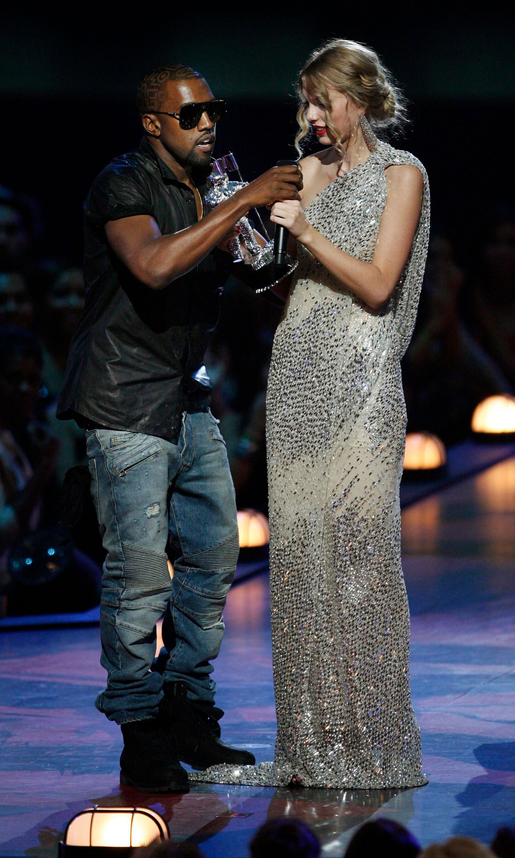"""Taylor Swift Wrote About Kanye Crashing VMAs Stage in 2009 Diary Entry - Kanye West takes the microphone from Taylor Swift as she accepts the """"Best Female Video"""" award during the MTV Video Music Awards on in New York City on September 13, 2009."""