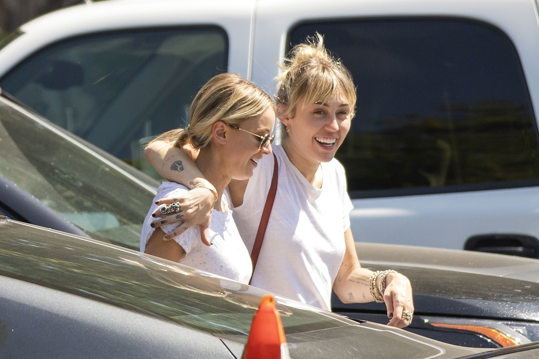 Miley Cyrus Gets Close With Kaitlynn Carter at Lunch Over Labor Day Weekend Wearing White Shirts