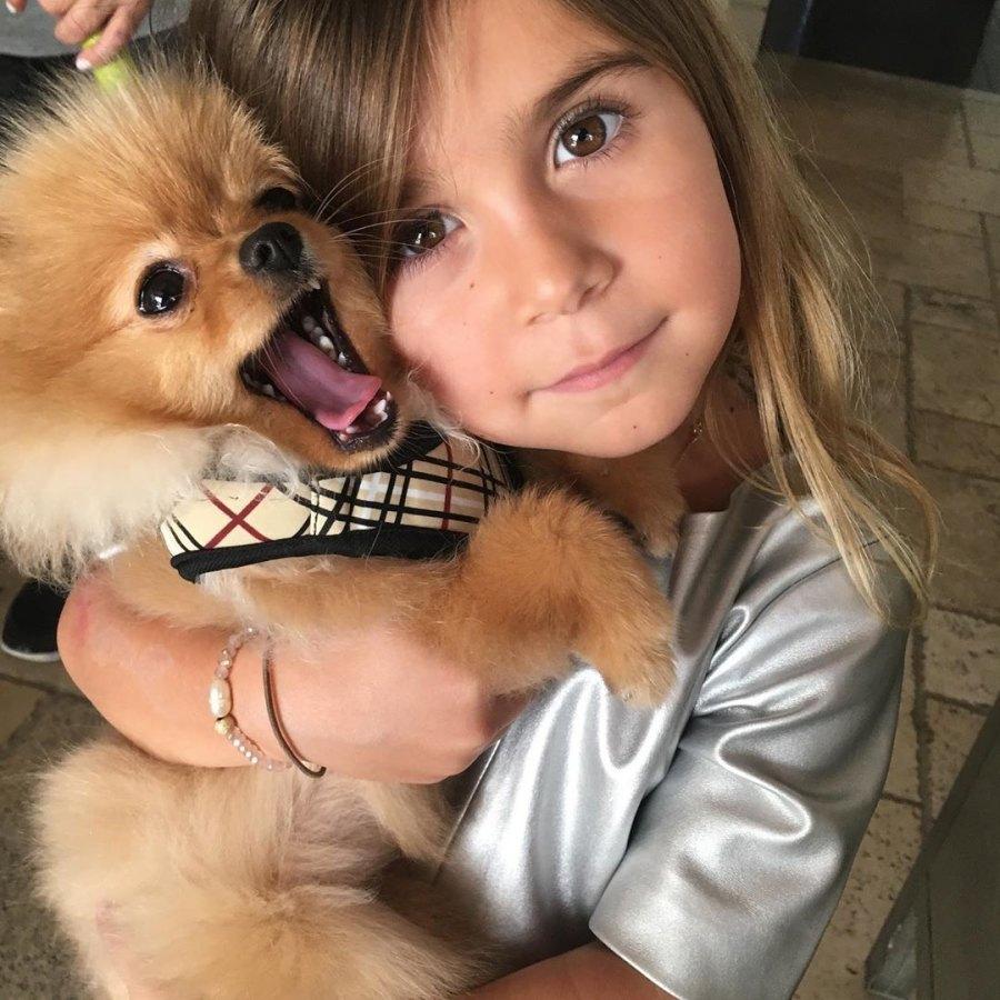 Penelope Disick Hugs Puppy