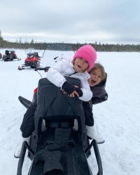 Penelope Disick Photo Album Making Faces with Reign Disick on Snowmobile in Finland