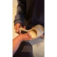 Saint-put-new-Yeezys-on-his-little-brother's-feet
