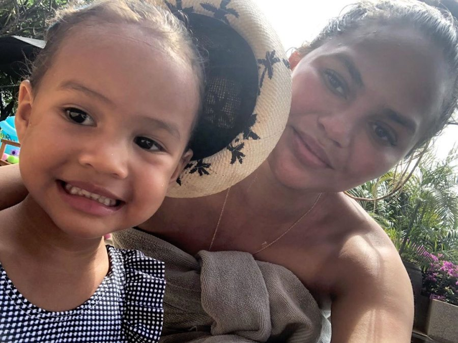 Chrissy Teigen Responds to Fan Who Is Worried Luna Is Too Close to the Kitchen Stove: 'It's Been Off for Hours'