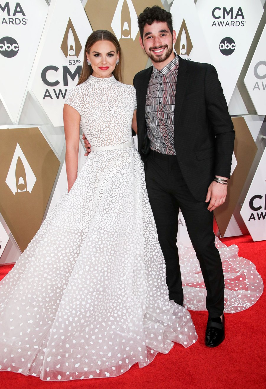 Hannah Brown and Alan Bersten 2019 CMA Awards Arrival Red Carpet White Dress