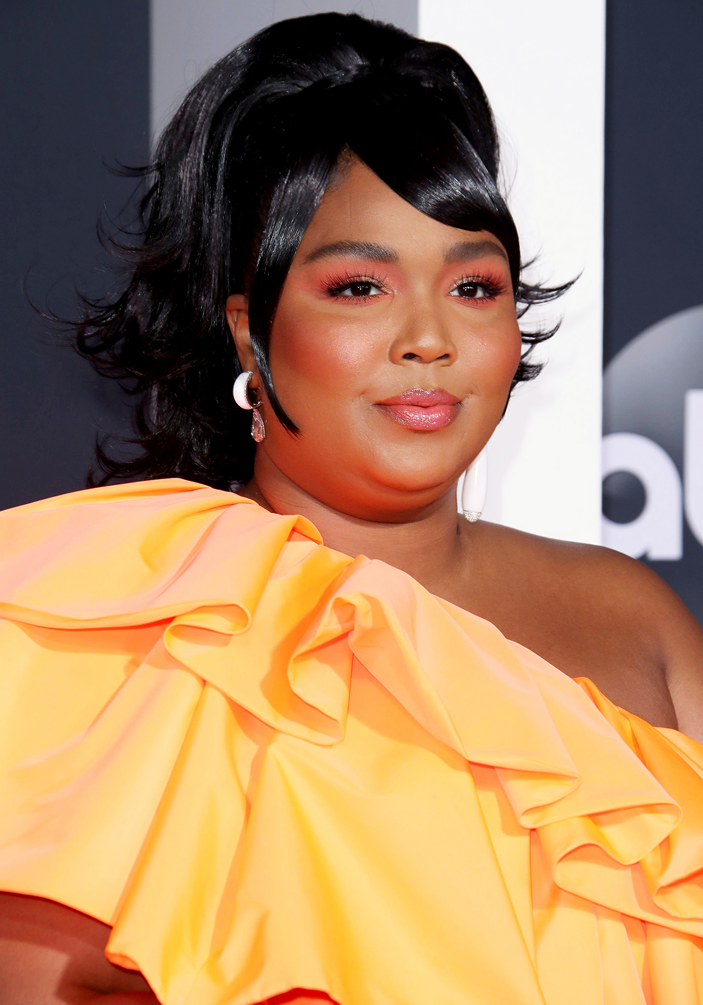 Lizzo Carries Tiny Valentino Purse at AMAs 2019