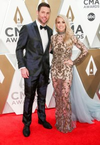 Mike Fisher and Carrie Underwood PDA Arrival Red Carpet 2019 CMA Awards