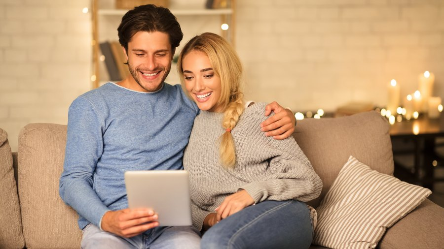 couple-looking-at-tablet