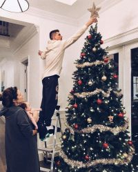 Celebrities Picking and Decorating Christmas Trees With Their Kids Robbie Amell and Italia Ricci